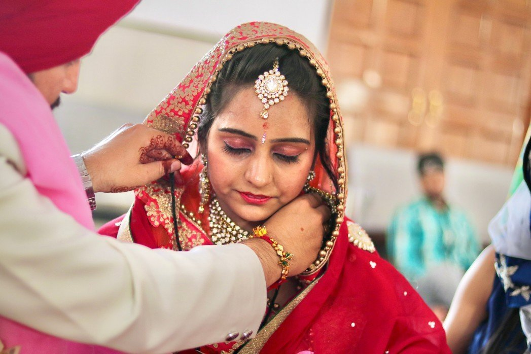 Mangalsutra is put on the Bride by Groom