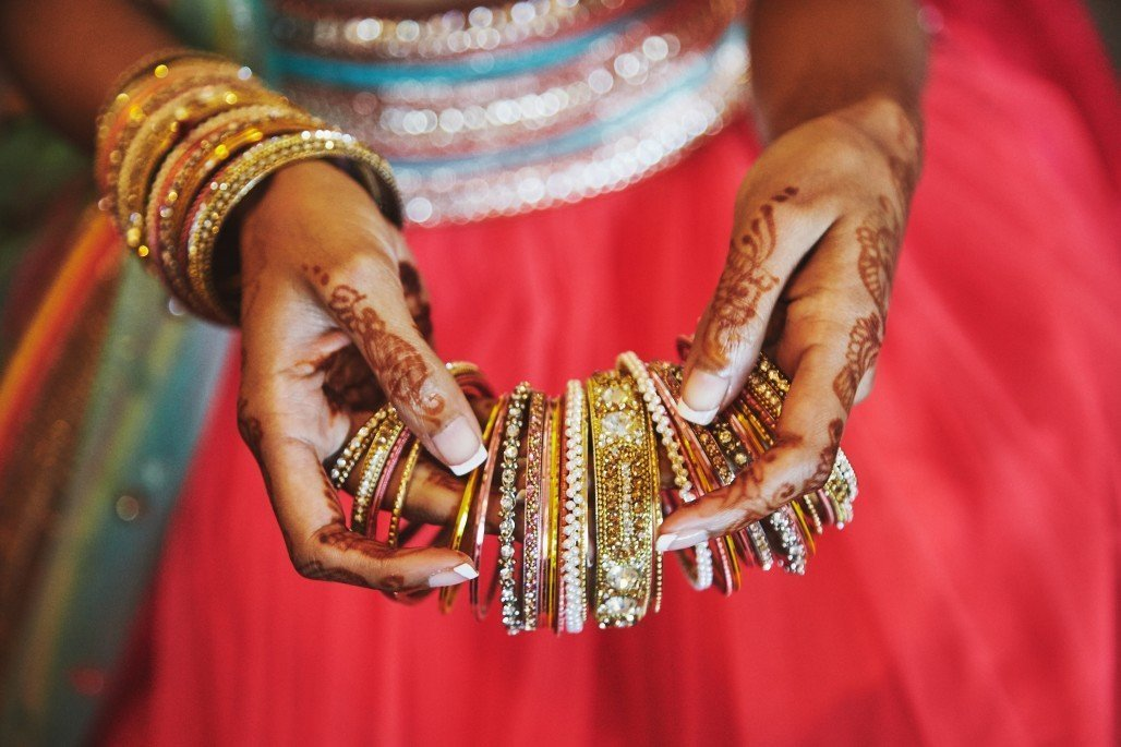 Bride Showing the Wedding Bangles she is wearing